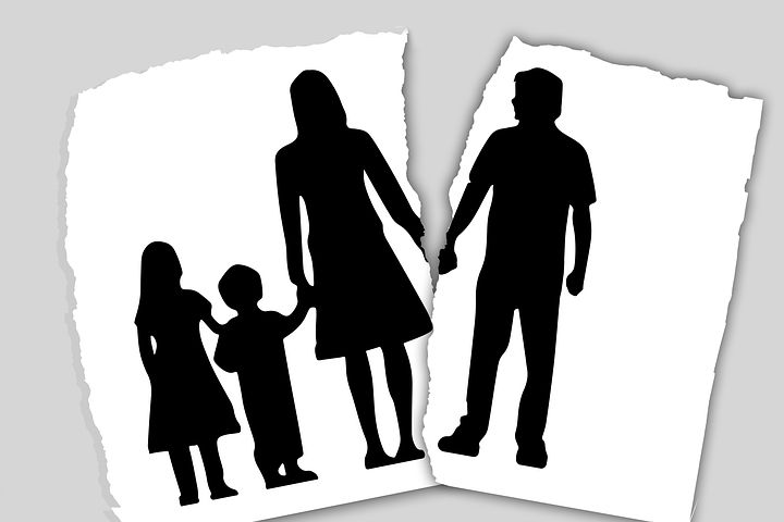 Family photo being torn apart - divorce concept
