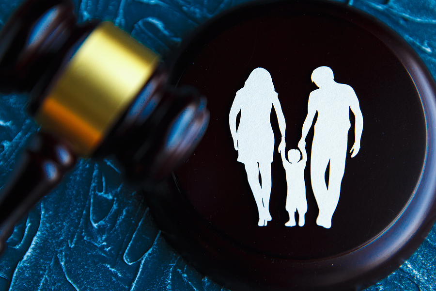 Gavel and a picture of a family. Family law concept